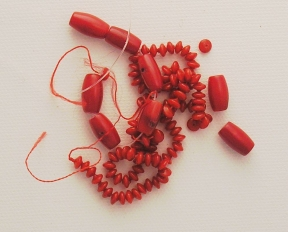 Photo of red coral beads