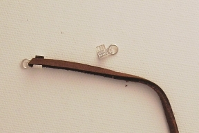 Photo - Attaching a tab end to leather cord